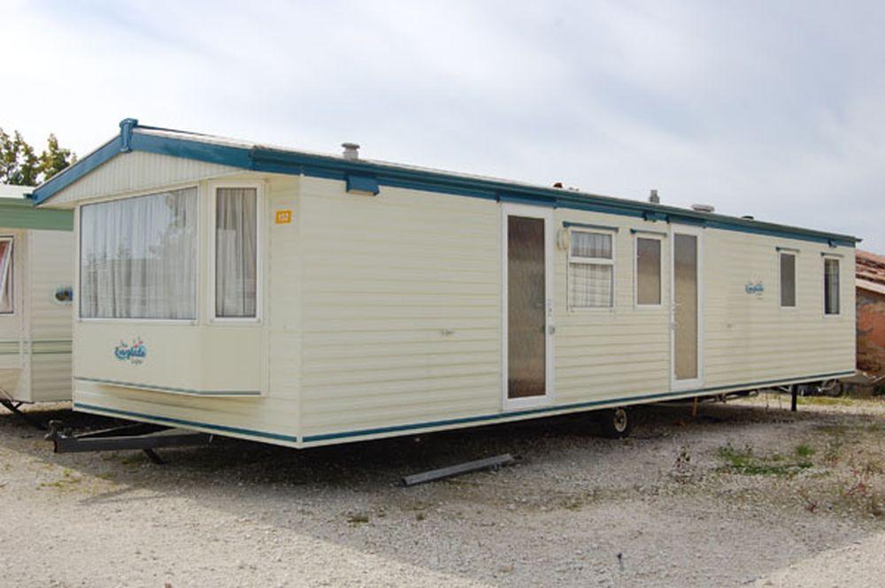 Casa móvil con lavadora 11×3,70 m 2 Dormitorios